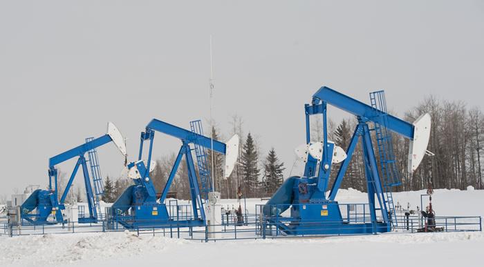 Pump jacks on a oil field in Southern Alberta