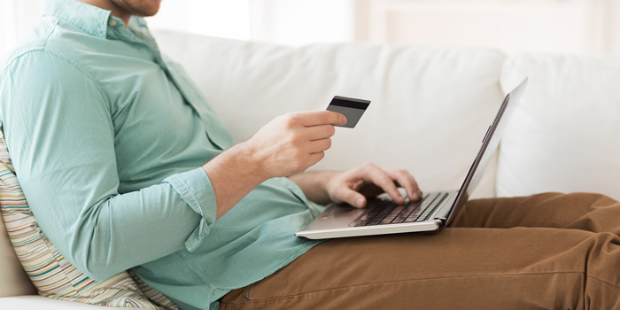 Man banking on couch